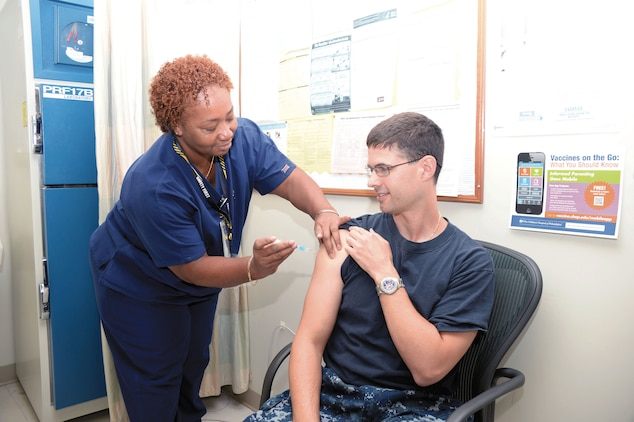 Navy Lt. Jason Slingerland, a new physician at Naval Branch Health Clinic Albany, receives a flu shot Oct. 10 at the clinic from Sheryl Taylor, a certified medical assistant.