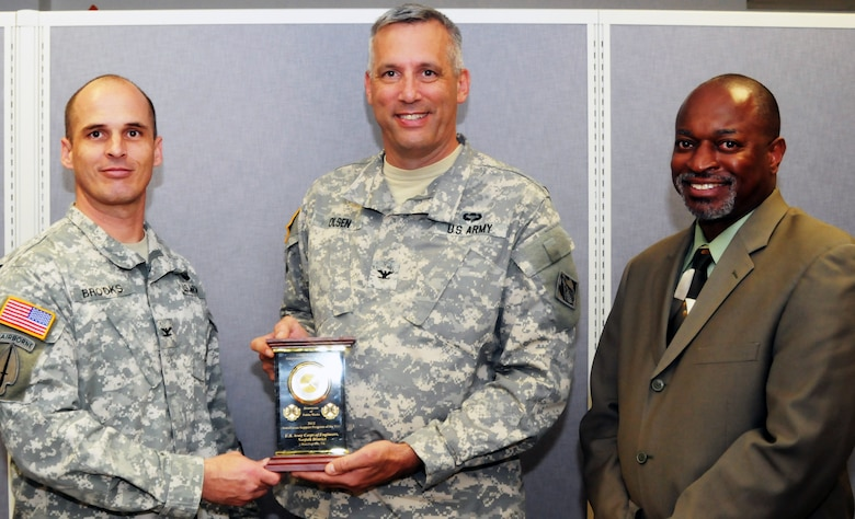 Col. Paul Brooks, Fort Lee garrison commander, presents the 2012