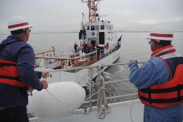 U.S. Army Corps of Engineers San Francisco District crew members Steve Roehner, left, and Rick Curry secure lines during an emergency towing exercise with Bay Area Coast Guardsmen July 9.