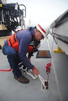 U.S. Army Corps of Engineers San Francisco District crew member Steve Roehner ties down a line during an emergency towing exercise with Bay Area Coast Guardsmen July 9.
