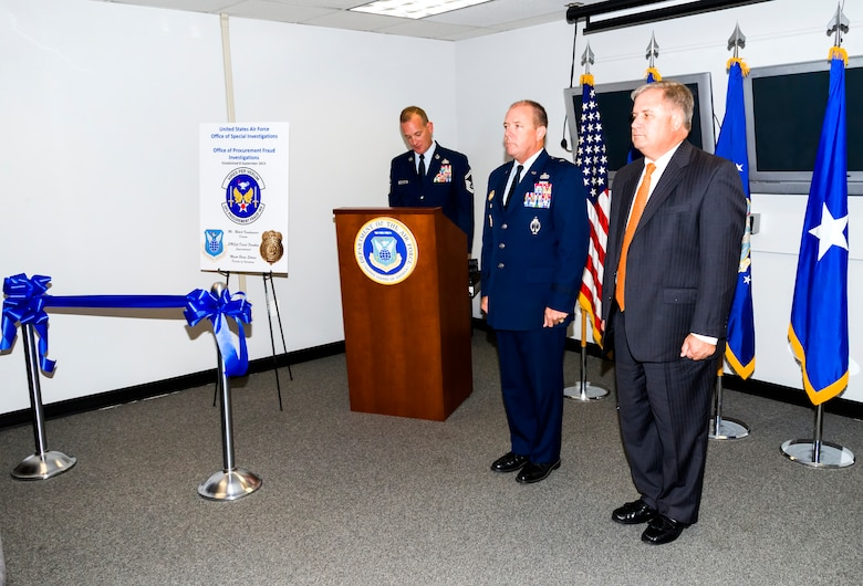 Brig. Gen. Kevin J. Jacobsen, Air Force Office of Special Investigations commander, middle, and Mr. Bob Kwalwasser, OSI Office of Procurement Fraud director, right, stand by during the PF office activation ceremony held October 17. With the creation of this new office, OSI will more effectively be able to centralize and consolidate procurement fraud investigations, which further promotes a renewed and sustained emphasis on combatting fraud.  (U.S. Air Force photo/Mike Hastings)