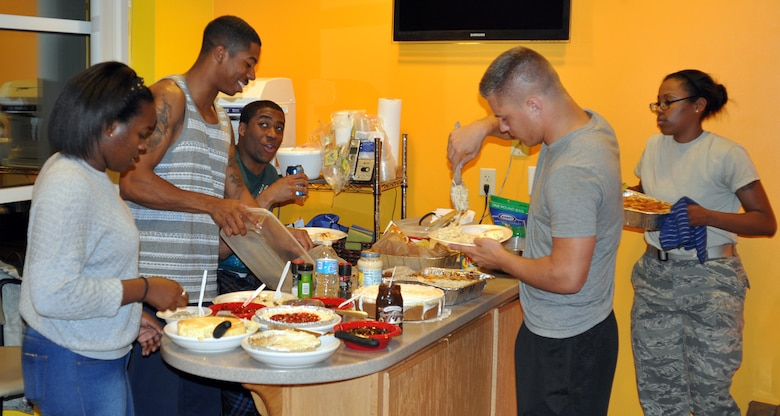 "Airmen serve themselves during ""Throwdown Thursday"" at the Connection on Oct. 10 in Tuskegee Hall, Offutt Air Force Base, Neb. Throwdown Thursday began in September with more than 45 single enlisted military members in attendance. (U.S. Air Force photo by Senior Airman Peter R.O. Danielson/Released)"
