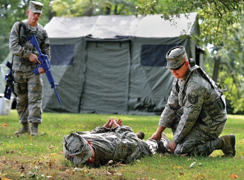 "WRIGHT-PATTERSON AIR FORCE BASE, Ohio – Tech. Sgt. Timothy Sexton, 445th Security Forces Squadron, handcuffs and searches an ""uncooperative person"" during the 445th SFS training exercise held Sept. 6-7 at Powell Park near here. (U.S. Air Force photo/Tech. Sgt. Frank Oliver)"