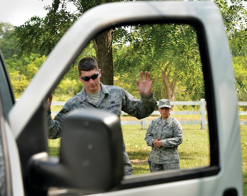 WRIGHT-PATTERSON AIR FORCE BASE, Ohio – Airman First Class Courtney Harry practices a felony traffic stop as Airman First Class Josh Huber exits his vehicle. Both are assigned to the 445th Security Forces Squadron. The scenario was part of the 445th SFS training exercise held Sept. 6-7 at Powell Park near here. (U.S. Air Force photo/Tech. Sgt. Frank Oliver)