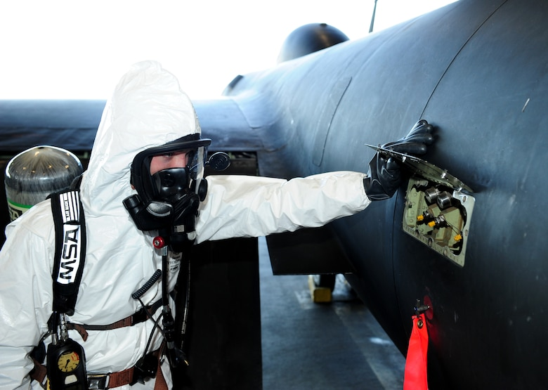 Senior Airman James Everson, 9th Maintenance Squadron aircraft fuels systems technician, inspects a hydrazine indicator on a U-2 Dragon Lady during a hydrazine response exercise Oct. 11, 2013, at Beale Air Force Base, Calif.  Hydrazine enables emergency restarts of the aircraft. (U.S. Air Force photo by Airman 1st Class Bobby Cummings/Released)
