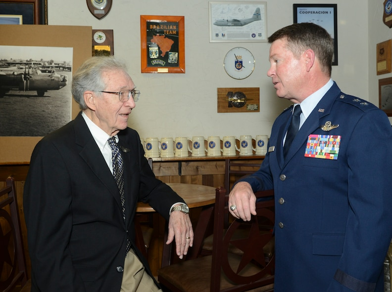 U.S. Air Force Maj. Gen. John F. Nichols, Texas adjutant general and commander, Texas Military Forces discusses the 28th mission of Thomas P. Faulkner, a former pilot and 1st. Lt. of the U.S. Army Air Forces' 15th Air Force, in Italy during WWII where he earned his Distinguished Flying Cross in 1945. Faulkner is officially receiving his DFC 68 years after the fact at the 136th Airlift Wing, Naval Air Station Fort Worth Joint Reserve Base, Texas, Sept. 19, 2013. (Air National Guard photo by Senior Master Sgt. Elizabeth Gilbert/released)