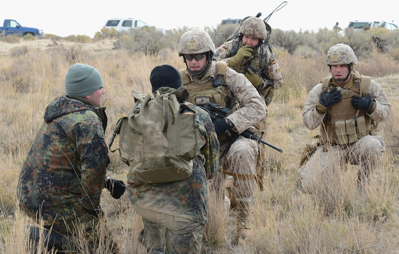 Marines from 1st Air Naval Gunfire Liaison Company and German Air Force joint terminal attack controllers speak with aircrew during a search and rescue training exercise Oct. 14, 2013, at Saylor Creek range. More than 300 Germans and Canadians, and an equal number of U.S. Navy, Marine Corps, Army and Air Force are participating in ground operations, close-air support, urban combatives, convoy operations, basic fighter maneuvers, counter air and multiple air-to-air training scenarios. (U.S. Air Force photo by Senior Airman Benjamin Sutton/RELEASED)