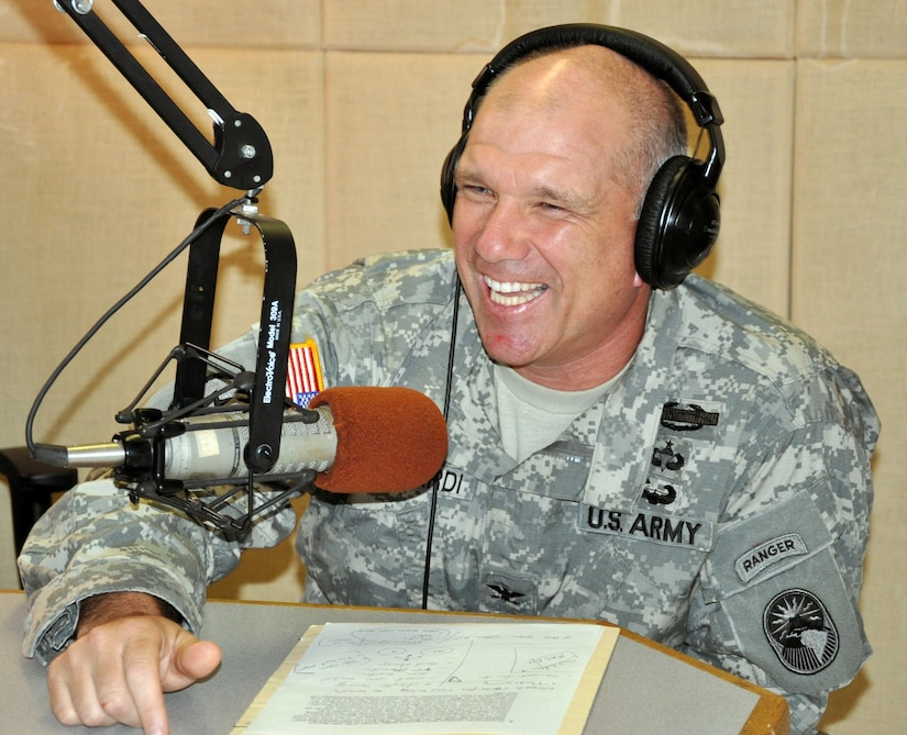 U.S. Army Col. Thomas Boccardi, Joint Task Force-Bravo commander, paid a visit to the American Forces Network-Honduras radio studio, Oct. 16, 2013. Col. Boccardi was hosted live on the air by U.S. Army Staff Sgt. Michael Sparks. The commander discussed several current issues affecting members of Joint Task Force-Bravo. (U.S. Air Force photos by Capt. Zach Anderson)