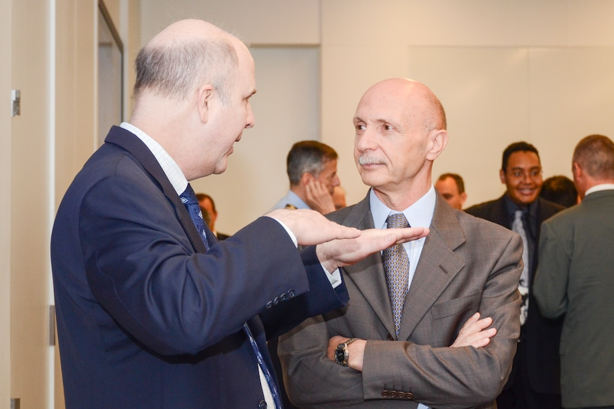 AFOSR Acting Director, Dr. Patrick Carrick conversing at the Air Force Office of Scientific Research (AFOSR) and the Embassy of Italy technical exchange meeting in held in Arlington, Va.
