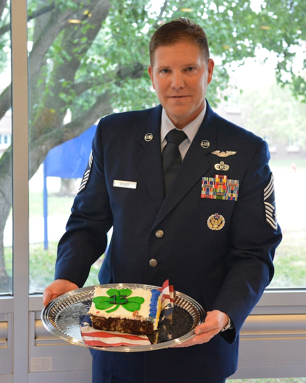 Chief Master Sgt. Thomas K. Stoudt, 13th commandant of the Paul H. Lankford Enlisted Professional Military Education Center here, holds a section of his change of commandant cake Oct. 17 on the I.G. Brown Training and Education Center campus at Spruance Hall. (U.S. Air National Guard photo by Master Sgt. Kurt Skoglund/Released)