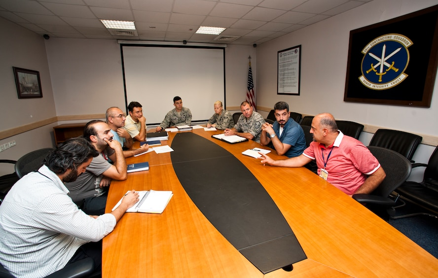 Members of the 39th Contracting Squadron gather for a meeting Sept. 19, 2013, at Incirlik Air Base, Turkey. Their flights prepare project packages for every contract on base. (U.S. Air Force photo by Senior Airman Daniel Phelps/Released)