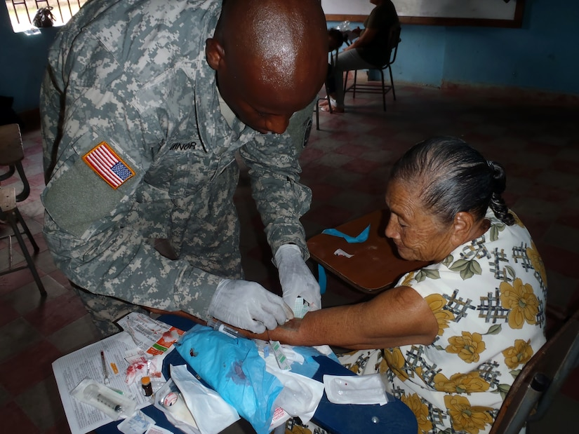 Members of Joint Task Force-Bravo's Medical Element (MEDEL) provide medical care to Honduran citizens during a Medical Readiness Training Exercise (MEDRETE) in the Department of Comayagua, Honduras, Oct. 17, 2013.  Joint Task Force-Bravo partnered with the Honduran Ministry of Health and the Honduran military to provide medical care to more than 900 people during the operation.  (Photo by U.S. Army Sgt. Courtney Kreft)