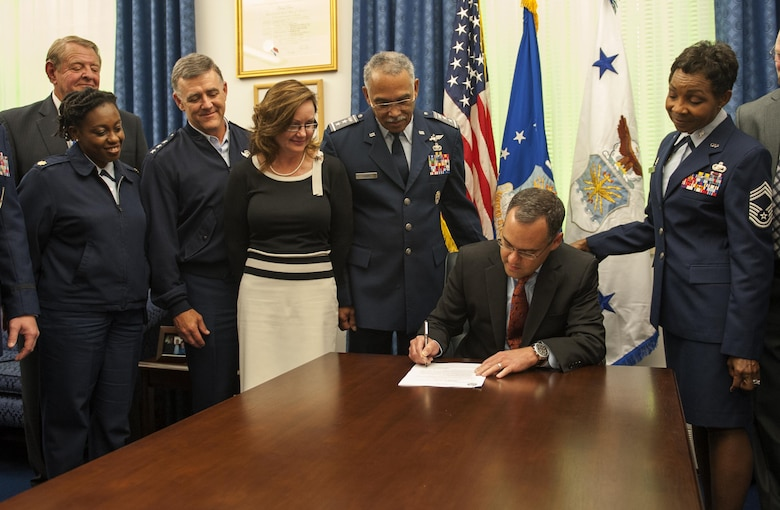 Daniel Ginsberg approves a proposal for the Civil Air Patrol to restructure their non-commissioned officer corps Oct. 18, 2013, in Washington, D.C. Now, with the newly-established NCO corps structure, NCOs will be able to progress and promote through the ranks similar to the Air Force. Ginsberg is the assistant secretary of the Air Force for manpower and Reserve affairs.