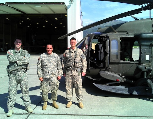 Col. Christopher Lestochi (center), commander of the U.S. Army Corps of Engineers – Alaska District, poses with Capt. Robert Weakland (left) and Maj. Eric Marcellus (right) in front of a UH-60 Blackhawk helicopter on Joint Base Elmendorf – Richardson in June 2013. Weakland and Marcellus are both civil engineers for the Alaska District and serve as aviators in the Alaska Army National Guard's 1st Battalion, 207th Aviation Regiment.