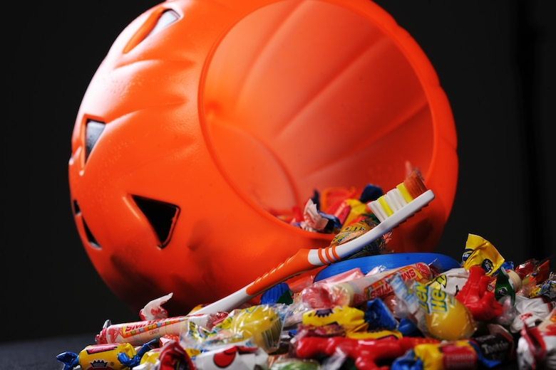 The 99th Dental Squadron is encouraging Airmen and their family members to develop an oral hygiene plan when eating candy during Halloween in order to prevent cavities. For cavities to form, four specific factors must be present concurrently: a susceptible tooth surface, cavity-forming bacteria, sugar and time. (U.S. Air Force photo illustration by Airman 1st Class Jason Couillard)