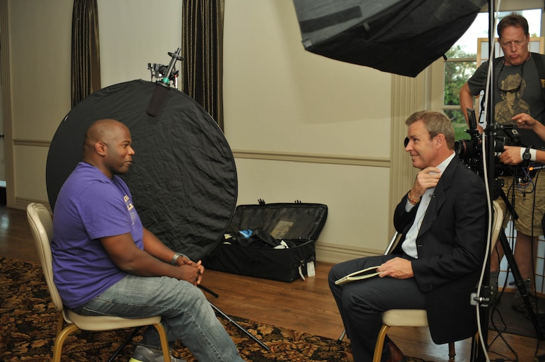 U.S. Air Force Tech. Sgt. Christopher Sankey, father of University of Washington Huskies' running back Bishop Sankey, is interviewed by ESPN correspondent, Tom Rinaldi, at Los Angeles Air Force Base's Fort MacArthur in San Pedro, Calif., Oct. 8, 2013.  Technical Sgt. Sankey's father, Albert, recently underwent successful eye surgery at UCLA just in time to see his grandson rush 125 yards and score twice during the Huskies' game against Stanford Oct. 5. (U.S. Air Force photo by Sarah Corrice)