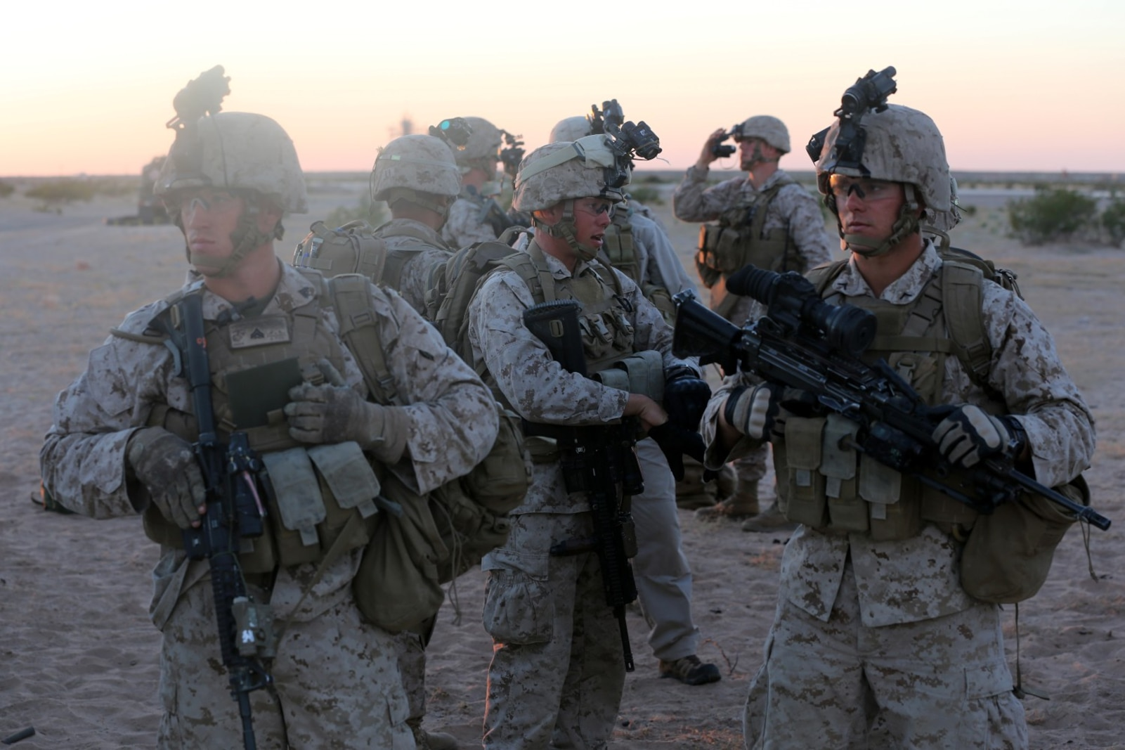 Marines with Bravo Company, 1st Battalion, 7th Marine Regiment, prepare their gear before a high value individual raid exercise here, Oct. 8, 2013. The Bravo Co. Marines inserted during night via CH-53E Super Stallion Helicopters and patrolled to a nearby road where a Marine role playing as a suspected high-ranking insurgent traveled. Once the suspected vehicle arrived, the Marines stopped the travelers, searched and questioned each individual and searched the vehicle for weapons and other forms of intelligence. The battalion is participating in Weapons Training Instructor course before deploying to Afghanistan this spring.