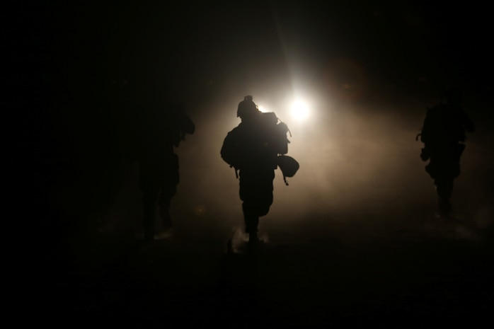 Marines with Bravo Company, 1st Battalion, 7th Marine Regiment, sprint toward a vehicle with suspected insurgents during a high value individual raid exercise here, Oct. 8, 2013. The Bravo Co. Marines inserted during night via CH-53E Super Stallion helicopters and patrolled to a nearby road where a Marine role playing as a suspected high-ranking insurgent traveled. Once the suspected vehicle arrived, the Marines stopped the travelers, searched and questioned each individual and searched the vehicle for weapons and other forms of intelligence.