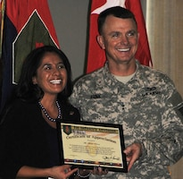 Guest speaker Madai Rivera poses with Maj. Gen. Paul E. Funk II, commanding general, 1st Inf. Div. and Fort Riley, after being presented with a certificate of appreciation for speaking at the Hispanic Heritage Observance Sept. 18 at Riley's Conference Center.  Photo by: Jessica Healey, POST.