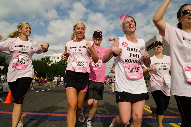 Capt. Candice Adams Ismirle and her bridesmaids cross the finish line of the Susan G. Komen Race for the Cure June 6, 2012, in Washington, D.C. Ismirle and friends completed the 5K race on the morning of her wedding. (U.S. Air Force photo by Staff Sgt. Russ Scalf)