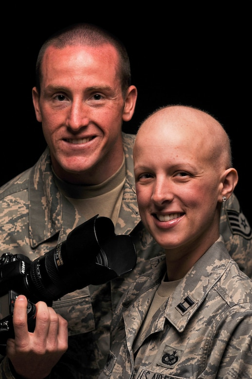 Staff Sgt. Russ Scalf and Capt. Candice Adams Ismirle pose for a studio photo April 8, 2011, at Fort George G. Meade, Md. (U.S. Air Force photo by Master Sgt. Justin Pyle)