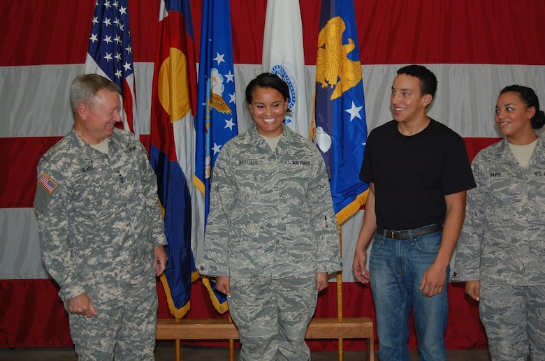 Gen. Frank Grass, chief, National Guard Bureau, spoke to the 233d Space Group during his visit and afterwards helped present awards and promote two individuals from the unit.  Senior Airman Amber Hatfield, 233 SG, earned another stripe to become a Staff Sergeant during the event. (Air National Guard photo by Capt. Kinder Blacke)