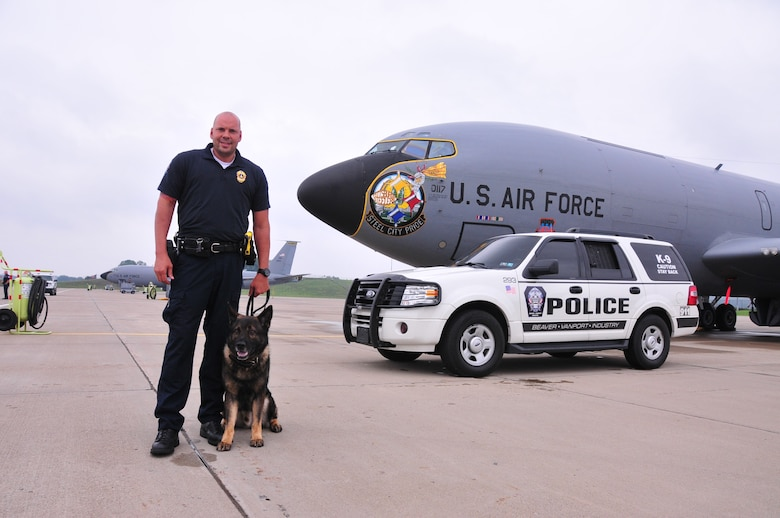 The 171st Air Refueling Wing, located near Pittsburgh, Pennsylvania, provides a secure location for local law enforcement agencies to train their K-9 units, August 28, 2013. Beaver County, Center Township, Findlay Township and Scott Township Police Departments attended. K-9 units must continuously train on building, vehicle, area, and evidence searches to fulfill training requirements. Training also includes apprehension, narcotic detection, tracking scenarios, and handler protection.  Having a secure, controlled location is important for efficient training and for the safety of the dogs. In addition to fulfilling training requirements, this combined effort also allows the 171st and local law enforcement agencies the ability to share ideas and training techniques in order to better serve the community and the commonwealth (U.S. Air National Guard Photo by Tech. Sgt. Shawn Monk/Released)