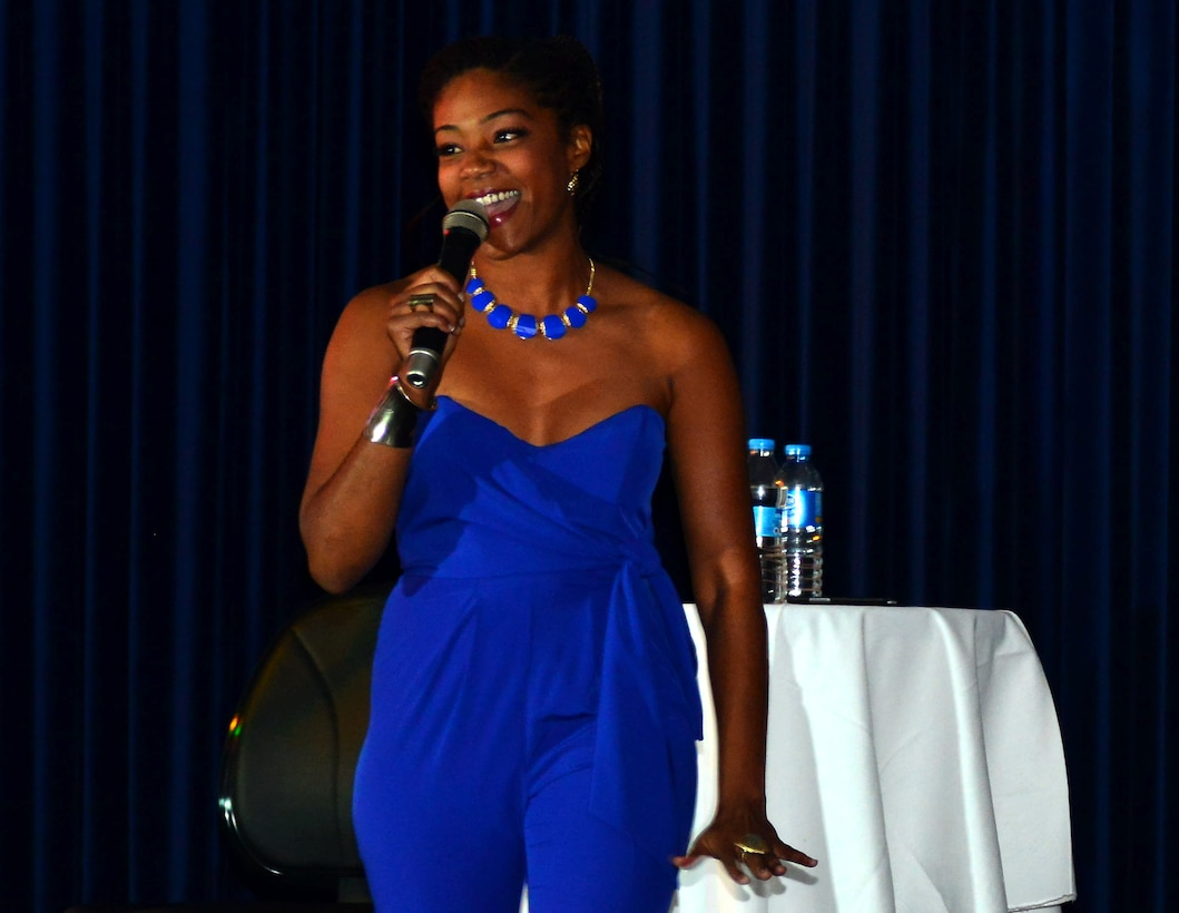 Tiffany Haddish, comedian, tells jokes to audience members during a performance Oct. 21, 2013, at Incirlik Air Base, Turkey. Her act was part of a tour sponsored by Armed Forces Entertainment to provide comedic relief to service members overseas. (U.S. Air Force photo by Staff Sgt. Eric Summers Jr./Released)