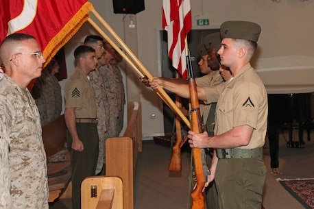 A Marine color guard from Marine Corps Forces Europe and Africa, present the colors during a memorial ceremony held at the base chapel for the Marines, soldiers and sailors killed in Beirut, Lebanon, Oct. 23.  On this day, 30 years ago, a truck with explosives drove up to the Marine barracks and detonated killing 241 service members.  Marines, sailors, and civilian Marines gathered to honor those service members who lost their lives but also the 58 French paratroopers who were also killed just minutes after the first attack.