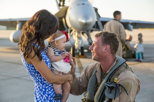 A Marine with Marine All-Weather Fighter Attack Squadron 533 smiles at his daughter after returning from a deployment, Oct. 10. Most of the squadron returned in mid-September, while some families waited a month longer to re-unite with their Marine.