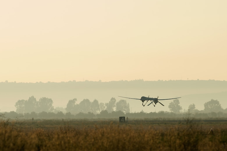 An MQ-1 Predator unmanned aerial vehicle attached to the 324th Expeditionary Reconnaissance Squadron takes off Oct. 22, 2013. (U.S. Navy photo/Mass Communication Specialist 2nd Class Brian T. Glunt)