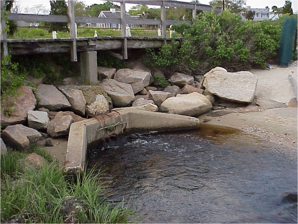 Only a 3-foot diameter culvert connected Stewart's Creek to salt water in Hyannis Harbor prior to the restoration project. The undersized culvert restricted tidal flushing and reduced the quality of estuarine resources on the upstream side. The Stewart's Creek Estuary Restoration Project is restoring approximately 14 acres of salt marsh and estuarine habitat in lower Stewart's Creek.