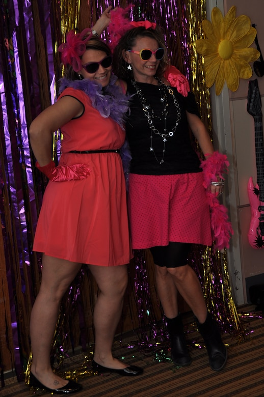 GOODFELLOW AIR FORCE BASE, Texas – Donna Casey, Sexual Assault Response Coordinator, and her sister, Mary Payton, pose for a photo at the photo booth during Girls Night Out, Oct. 19 at the Event Center. A fashion show and a photo booth were a part of this year's 80's theme. (U.S. Air Force photo/ Airman 1st Class Breonna Veal)