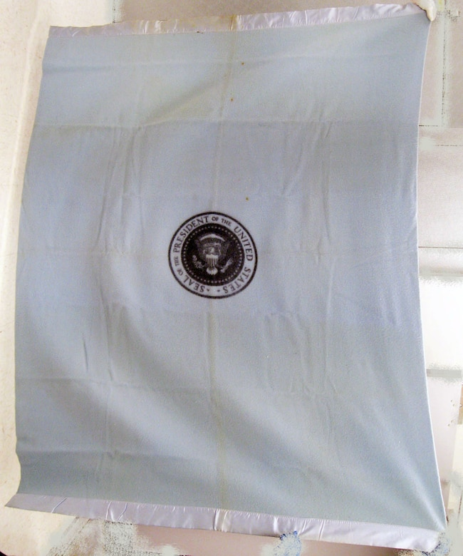 This blanket was used by President John F. Kennedy while flying aboard Air Force One. It was safeguarded by the pilot, James B. Swindal, on Nov. 22, 1963, the day of Kennedy's assassination. (U.S. Air Force photo)