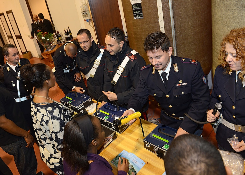 Carabinieri officers offer voluntary breathalyzers at the end of a responsible drinking event, Oct. 18, 2013, at Gelisi's Winery in San Quirino, Italy. The breathalyzer tests were used to show the Airmen how much alcohol they had in their system and to give them a better understanding of their alcohol limits. (U.S. Air Force photo/Airman Ryan Conroy)