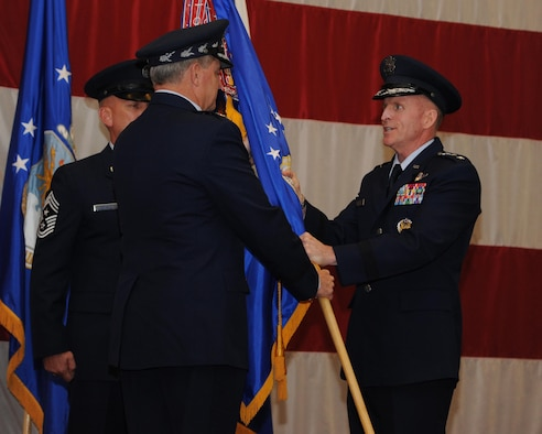 Lt. Gen. Stephen Wilson accepts the Air Force Global Strike Command flag from Air Force Chief of Staff Gen. Mark A. Welsh III during a change of command ceremony at Barksdale Air Force Base, La., Oct. 23, 2013. Global Strike's mission is to develop and provide combat ready forces for safe, secure, and effective nuclear deterrence and global strike operations to support the President of the United States and combatant commanders.
