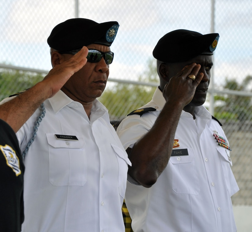 Lt. Col. Michael Frazier, Joint Task Force-Bravo Director of Civil Affairs, and Command Sgt. Maj. Norriel Fahie, Army Support Activity, render a salute during the playing of the Honduran national anthem during the Opening Ceremony for the Honduran Special Olympics at Carlos Miranda Stadium, Comayagua, Honduras, Oct. 24, 2013.  Joint Task Force-Bravo is providing support for the Honduras Special Olympics soccer tournament, which will be played at Soto Cano Air Base.  (U.S. Air Force photo by Capt. Zach Anderson)