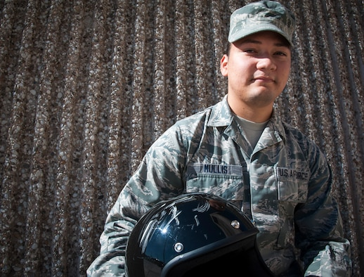 Airman 1st Class Randy Mullis, 47th Operations Support Squadron radar approach control operator, poses with the helmet that saved his life at Laughlin Air Force Base, Texas, Oct. 23, 2013. Recently, Mullis was thrown from his bike during an accident, landing head-first into a boulder near the road. According to the doctors that tended to Mullis, he would not have survived the crash if he was not wearing his helmet that day. (U.S. Air Force photo/Senior Airman John D. Partlow)