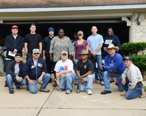 Members of the 147th Reconnaissance Wing that have volunteered their time and skills to make emergency critical repairs to a Vietnam Veteran's home. The Airmen teamed up with Rebuild Together Houston to make the repairs. National Guard photo by Master Sgt. Sean Cowher