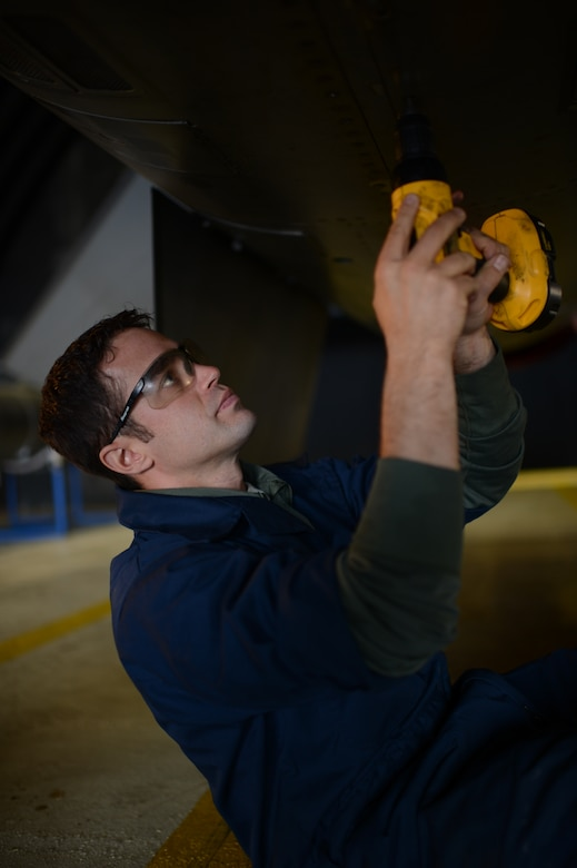 SPANGDAHLEM AIR BASE, Germany – U.S. Air Force Tech. Sgt. Brandon Fontaine, 480th Aircraft Maintenance Unit cannibalization manager from Erie, Pa., loosens a panel on an F-16 Fighting Falcon fighter aircraft during a cannibalization rebuild Oct. 22, 2013. A cannibalization rebuild involves replacing a removed aircraft's parts to maintain another's operational readiness. (U.S. Air Force photo by Airman 1st Class Gustavo Castillo/Released)