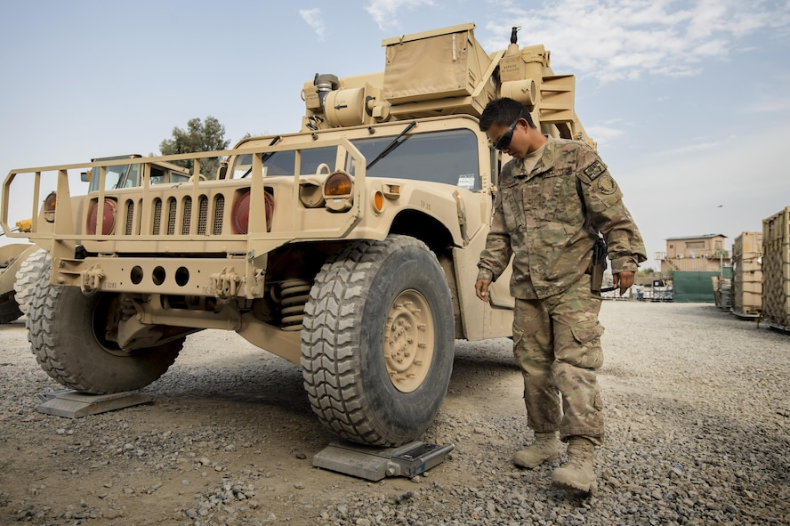 Senior Airman Leah Johnson checks the weight of a vehicle scheduled for shipping Sept. 22, 2013, at Forward Operating Base Salerno, Khost Province, Afghanistan. The 19th Movement Control Team a small squadron of Air Force surface movement controllers and aerial porters, oversee the vast majority of retrograde operations at FOB Salerno. Johnson, a St. Paul, Minn. native, is deployed from Travis Air Force Base, Calif. Johnson is a 19th MCT aerial porter, (U.S. Air Force photo/Master Sgt. Ben Bloker)
