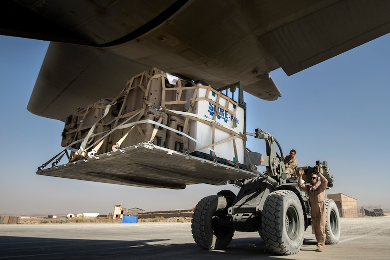 Senior Airman Zac Sidders marshals a pallet of cargo into a C-130 Hercules Sept. 28, 2013, at Forward Operating Base Sharana, Paktika Province, Afghanistan. This mission marked a retrograde milestone as the 774th Expeditionary Airlift Squadron transported the last cargo from FOB Sharana before the base is transferred to the Afghan Ministry of Defense. Sidders, a Peoria, Ill. native, is deployed from the Wyoming Air National Guard. Sidders is a 774th EAS loadmaster. (U.S. Air Force photo/Master Sgt. Ben Bloker)