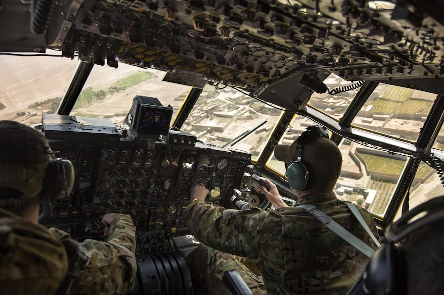 1st Lt. Brent Stevens and Maj. Devin Cummings maneuver a C-130 Hercules out of Forward Operating Base Sharana, Paktika Province, Afghanistan, Sept. 28, 2013. This mission marked a retrograde milestone as the 774th Expeditionary Airlift Squadron transported the last cargo from FOB Sharana before the base is transferred to the Afghan Ministry of Defense. Stevens, a Tampa, Fla. native, is deployed from Little Rock Air Force Base, Ark. Cummings, a Manitowoc, Wis. native, is deployed from Peterson Air Force Base, Colo. Cummings and Stevens are 774th EAS pilots. (U.S. Air Force photo/Master Sgt. Ben Bloker)