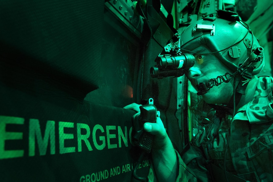 Senior Airman Larry Webster scans for potential threats using night vision goggles after completing a cargo airdrop Oct. 7, 2013, in Ghazni Province, Afghanistan. Webster is a 774th Expeditionary Airlift Squadron loadmaster. (U.S. Air Force photo/Master Sgt. Ben Bloker)