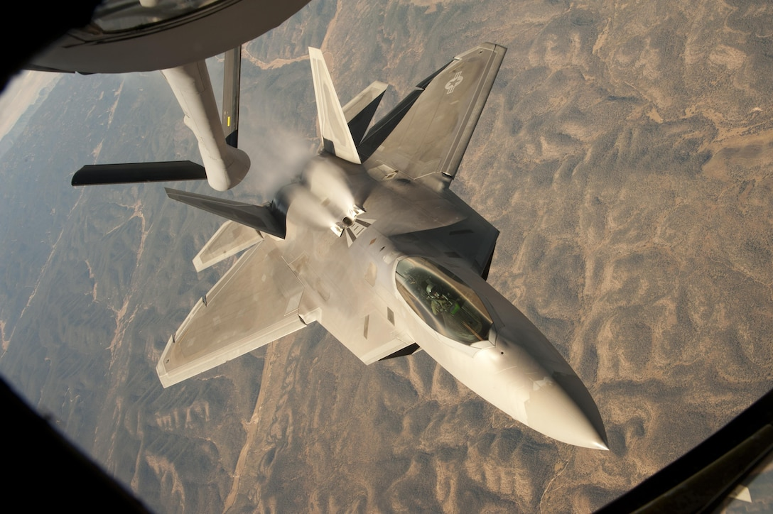 An F-22 Raptor backs away from a KC-135 Stratotanker during a training mission over central New Mexico Oct. 23, 2013. The Raptor is assigned to the 49th Fighter Wing, at Holloman Air Force Base, N.M. The KC-135 is from McConnell Air Force Base, Kan. (U.S. Air Force photo/Airman 1st Class John Linzmeier)