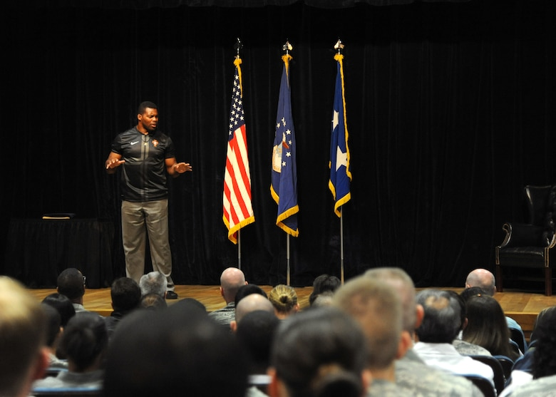 Herschel Walker speaks to more than 200 personnel from the 59th Medical Wing Oct. 23, 2013, at the Wilford Hall Ambulatory Surgical Center, Joint Base San Antonio-Lackland, Texas. As part of the Department of Defense Patriot Support Program's Anti-stigma campaign, Walker visits military installations across the country to encourage service members to seek help for mental health and substance abuse issues.