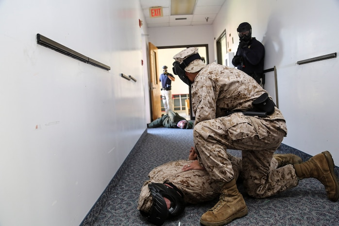 Marines with the Provost Marshal's Office aboard Marine Corps Air Station Beaufort conduct active shooter training aboard Marine Corps Recruit Depot Parris Island, Oct. 15. To make training realistic they used airsoft pistols, handcuffs, fake pepper spray and fake electroshock weapons to suppress the shooter.