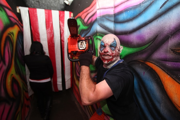 A clown rushes oncomers at the Panic Attack haunted attraction in Wilmington, N.C. Oct. 18. Panic Attack is one of the largest haunted houses in North Carolina, and is convienently located in proximity to Marine Corps Base Camp Lejeune and Marine Corps Air Station New River,