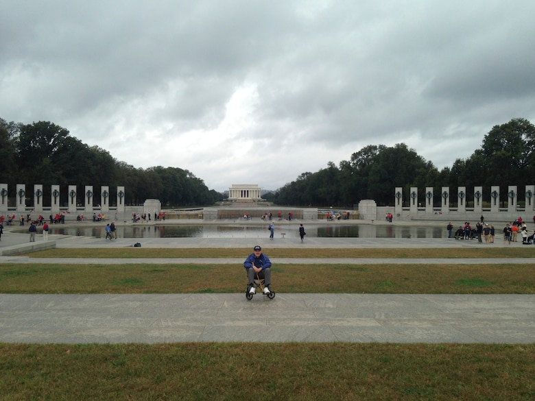 Robert Yeschek, a World War II, Korean War and Vietnam War veteran, poses at the World War II memorial in Washington D.C. during Honor Flight, Oct. 7, 2013. Honor Flight began in May 2005 after, Earl Morse, a retired Air Force Captain began working at the Veteran's Affairs Hospital noticed that most of his patient did not know that the World War II memorial existed. (Courtesy photo)