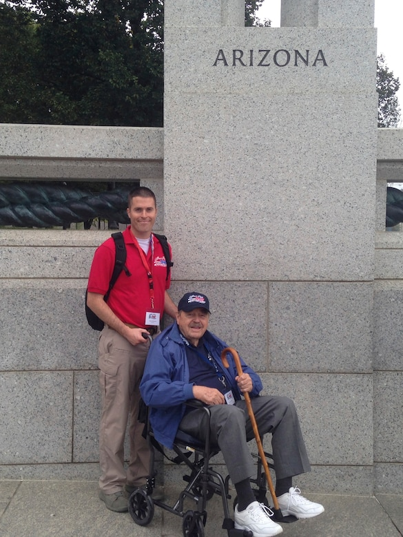U. S. Air Force Staff Sgt. David Wilcken, 612th Air and Space Operations Center air tasking order production technician, and Robert Yeschek, a World War II, Korean War and Vietnam War veteran, pose at the World War II memorial in Washington D.C., Oct. 7, 2013. Wilcken flew with Yeschek during Honor Flight to be his guardian for the duration of the trip. (Courtesy photo)